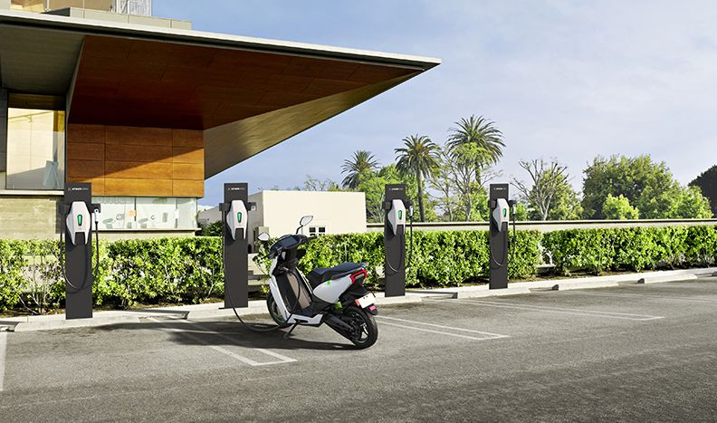 The Ather 450 scooter is charging at one of four charging spaces.