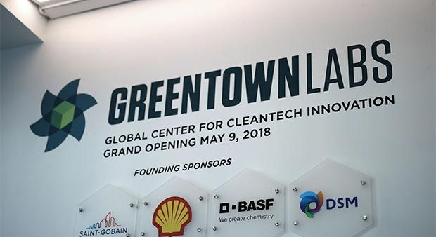 """Sign reading """"Greentown Labs. Global Center for Cleantech Innovation. Grand Opening May 9, 2018."""" Plaques for founding sponsors under sign."""