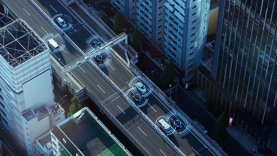 Illustration of city streets seen from above with cars on road and circles of sensors around each car.